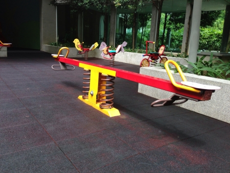 Spring balance on playground in a condominium