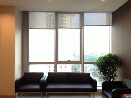 Brightly lighted office waiting area with scenery