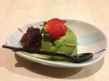 Matcha ice cream with red bean and strawberry topping desert