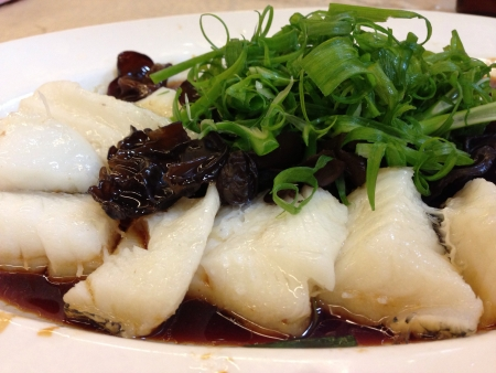 Steamed cod fish cooked with black fungus and soy sauce