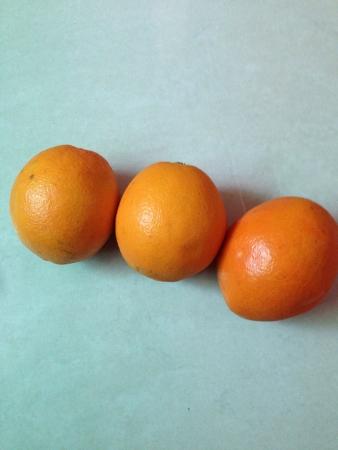 Three oranges on the floor