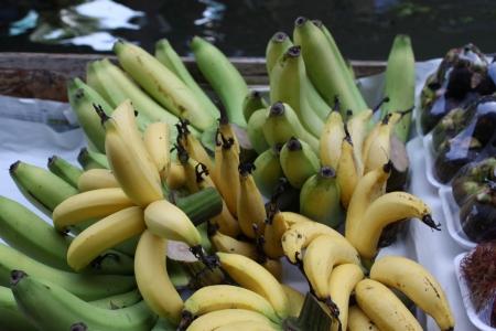 Tropical Fruits selling on boat at Damnoen Saduak Floating Market near Bangkok in Thailand