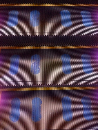Escalator footstep guide in shopping mall