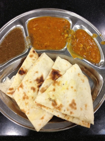 Naan bread with curry dips Stock Photo