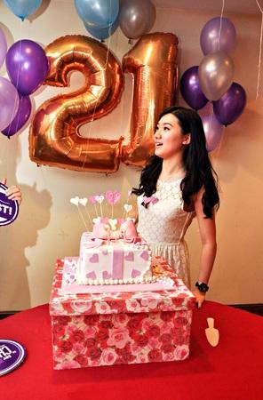 Young asian adult enjoying birthday surprise