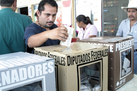 voted: Man voting for President in mexican elections Editorial