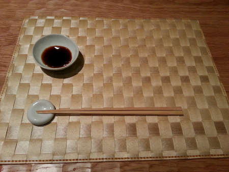 placemat: Japanese chopsticks and soya on placemat Stock Photo