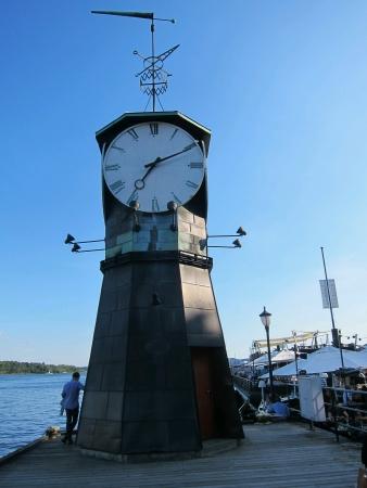 beside: Creative clock tower beside sea