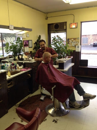 Barber cuts hair Stock Photo - 23966283