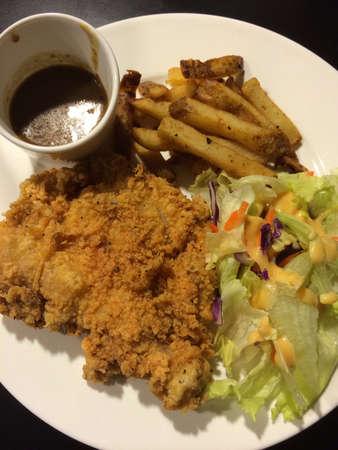 chicken chop: A chicken chop on a plate Stock Photo