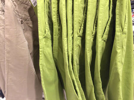 pants: Beige and lime green pants Stock Photo