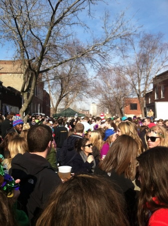 mardigras: A mass of people in the streets celebrating mardis gras in St. Louis  Stock Photo