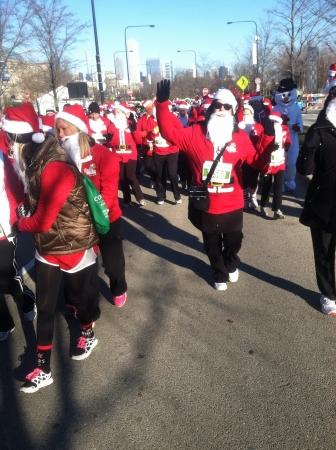 hustle: Santas outside for the Santa hustle in chicago Stock Photo