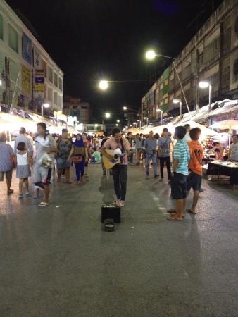 night market: A street musician is singing at night market in Krabi Thailand