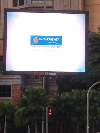 TV advertising outside Berjaya Times Square  Stock Photo