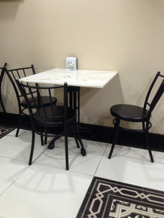 Simple 3 person seating in small restaurant