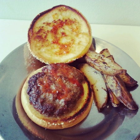 potato wedges: Home made delicious lamb burger served with potato wedges Stock Photo
