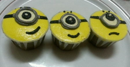 eye: Three single eye Minions cupcakes  Stock Photo