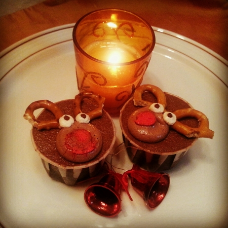 chocolaty: Cute chocolaty rain deee cupcakes for a perfect Christmas added with fragrant candle and bells Stock Photo