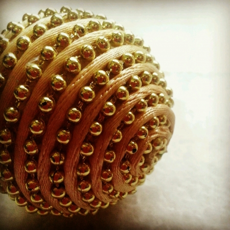 shiny: Gold beaded Christmas ornament