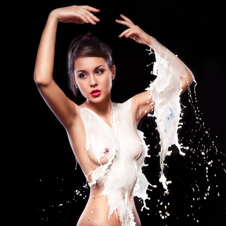 woman bathed splashes of milk photo