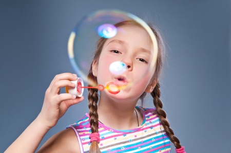 girl inflates very big bubble