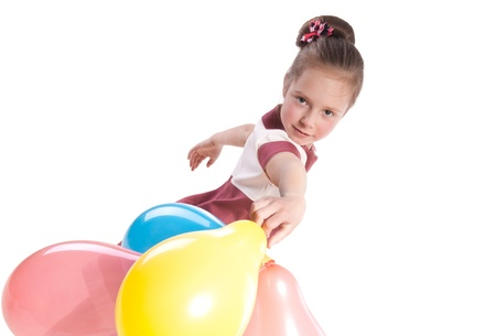 little girl with multicolored  balloons photo