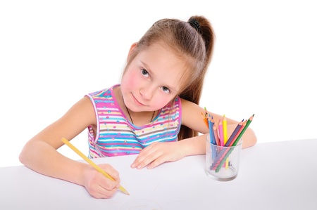 Girl drawing with colored pencils photo