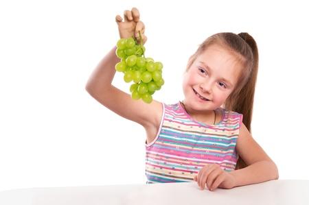girl holds a grape-vine photo