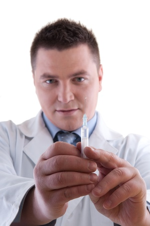 male Doctor preparing anesthetic syringe. Shallow depth of field with focus on the front placed syringe.