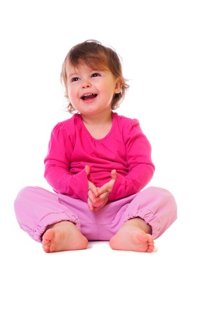 little baby sitting and smiling. pink clothing. isolated on white Stock Photo