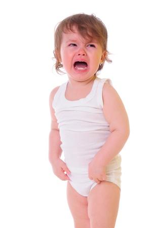 fille pleure: isol� sur blanc petite enfant pleure dur larmes coulent sur ses joues photo en haute cl�