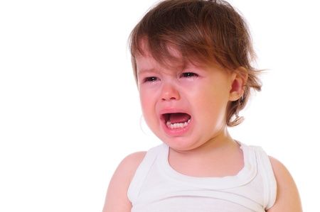 unsatisfied: isolated on white  small child is crying hard  Tears stream down his cheeks  photo in high-key