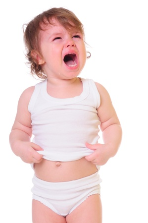 tantrum: isolated on white  small child is crying hard  Tears stream down his cheeks  photo in high-key