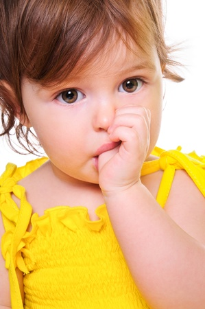 sucking: small child holding a finger in his mouth  studio photos  Close-up portrait  isolated on white