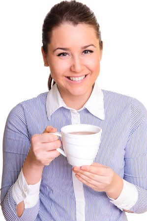 beautiful young woman holding a cup of tea in hand  positive smile  isolated on white  Stock Photo - 13084383