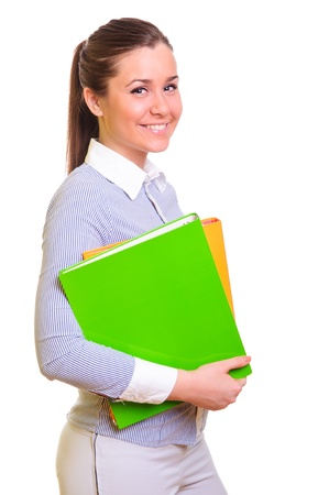 attractive businesswoman holding folder in hands  positively smiling  isolated on a white background Stock Photo