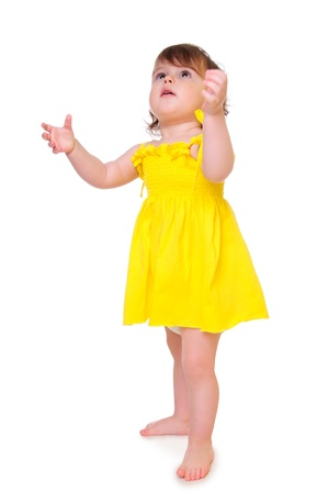 little girl held out her hands up playful toddler isolated on a white background
