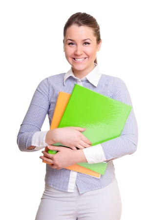 attractive businesswoman holding folder in hands  positively smiling  isolated on a white background Stock Photo - 13315057