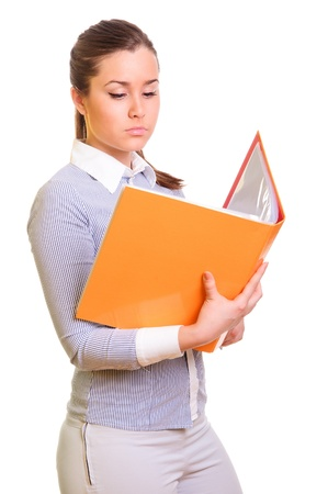 attractive businesswoman holding open folder in hands  centered view  isolated on a white background Stock Photo - 13314874