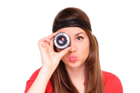 woman looks in the camera lens. shows the internal mechanism. positively smiling. close-up photo