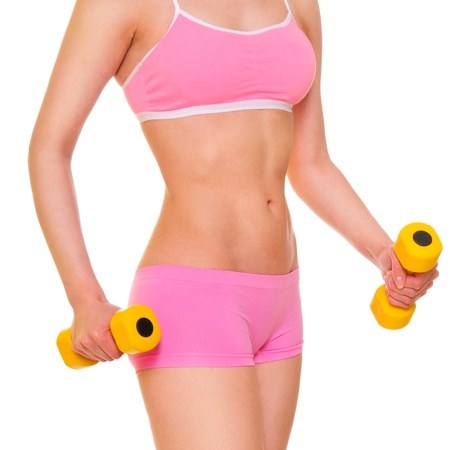 beautiful woman's body. unrecognizable. exercises with two yellow dumbbells. isolated on a white background Stock Photo - 13314858