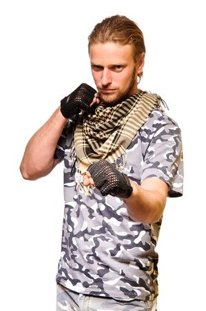 Muscular young soldier  in army clothes and camouflage paint  isolated on a white background Stock Photo - 13465071
