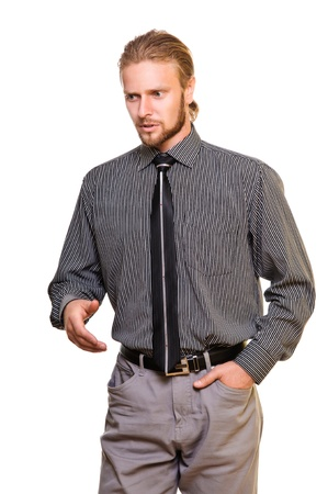 motioning: serious young man, motioning to the left shows. isolated on a white background Stock Photo