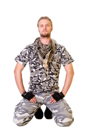 Muscular young soldier  in army clothes and camouflage paint. isolated on a white background