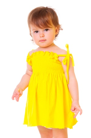 cute little girl in a yellow dress  portrait of a close-up in the studio  isolated on white photo