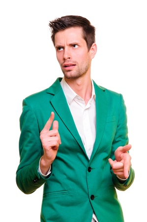 positive emotional young man in a green jacket  making expressive gestures  portrait isolated on white background Stock Photo - 13569269