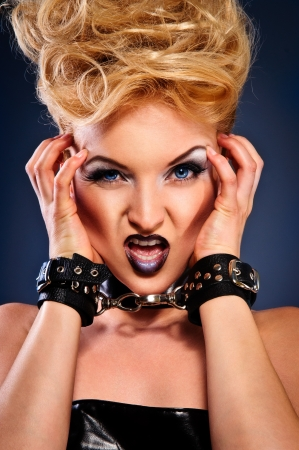 Artistic portrait of a young woman  emotions of anger and aggression  close-up Stock Photo - 14156992