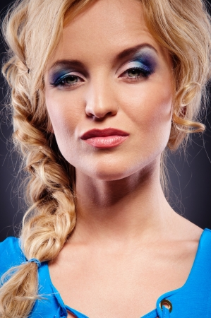 remorse: attractive young woman stares into the camera  Close-up portrait Stock Photo
