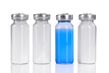 four vials for injection, with white and blue mortar. isolated on a white background